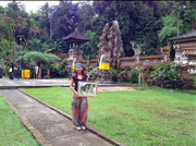 Rachma Lim with her completed landscape painting